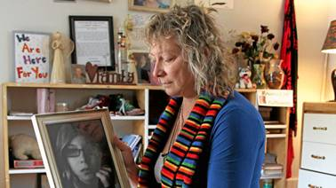 Donna Leslie looks a her daughter Loren's photo at her home in Vanderhoof. Leslie sits on a casket made for Loren, was signed by her friends in the comminity. Loren was cremated and here ashes are kept in Loren's Eeyore pillow bag. - Donna Leslie looks a her daughter Loren's photo at her home in Vanderhoof. Leslie sits on a casket made for Loren, was signed by her friends in the comminity. Loren was cremated and here ashes are kept in Loren's Eeyore pillow bag. | David Mah