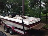 maroon and white, 21 foot, Malibu LXI Mercruiser boat