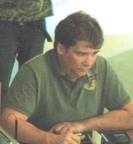 Photo of Barry Hinchcliffe wearing a green golf shirt with logo on left side of chest